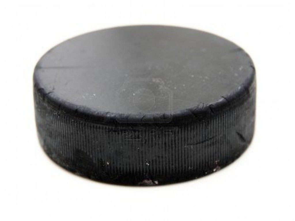 9396441-black-old-hockey-puck-isolated-on-white-background