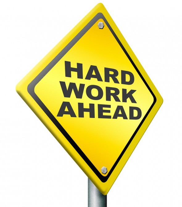 bigstock-hard-work-ahead-yellow-warning-28341908