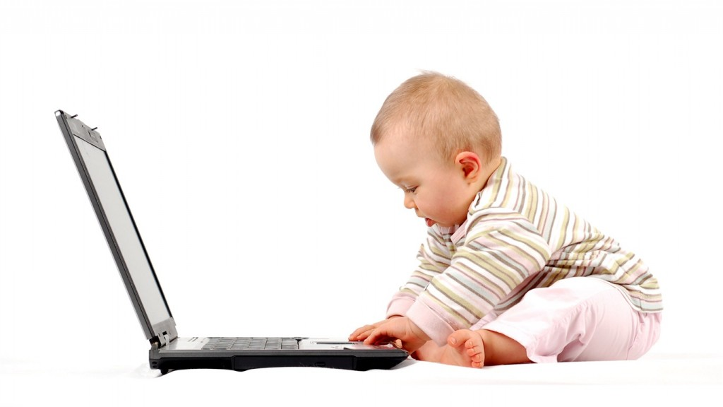 Cute-baby-playing-laptop_1366x768